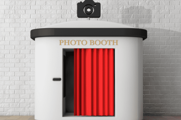 Photo Booth in front of brick wall